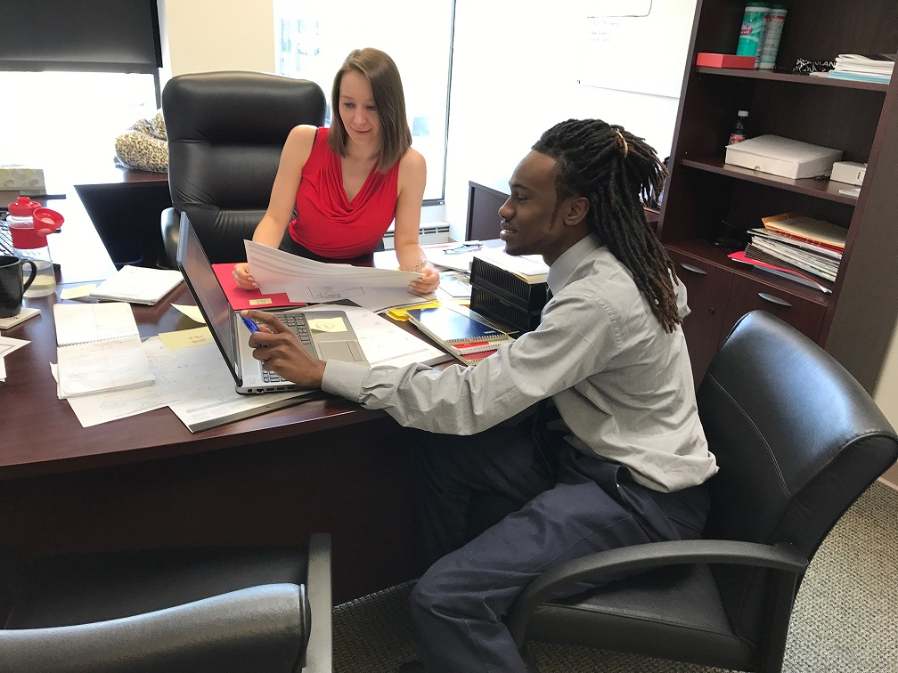 Anna Kuta helps Chicago All-Stars Project's Eddie Gardner complete a project during his summer internship at Inland Mortgage Capital. For more information on Chicago All Stars Project, Inc., please visit: https://allstars.org/locations/chicago/